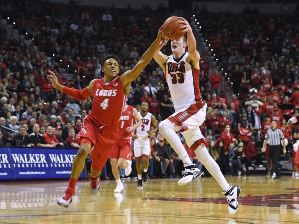 New Mexico guard Elijah Brown runs in to steal the ball from UNLV forward Stephen Zimmerman Jr. during their Mountain West basketball game Jan. 12, 2016, at the Thomas & Mack Center.  Sam Morr ...