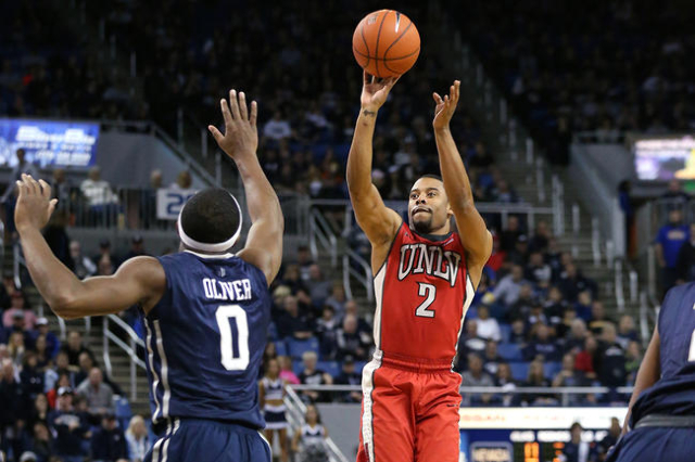 UNLV's Jerome Seagears shoots over Nevada defender Caneron Oliver during a men's college basketball game in Reno, Nev., on Saturday, Jan. 23, 2016. (Cathleen Allison/Las Vegas Review-J ...