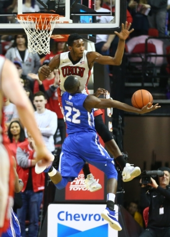 UNLV forward Derrick Jones Jr. (1) reaches to block a shot by Air Force guard Pervis Louder (22) during a basketball at the Thomas & Mack Center in Las Vegas on Saturday, Jan. 16, 2016. Chase  ...