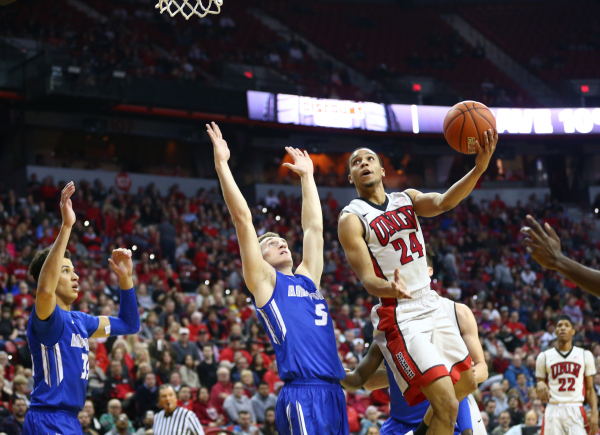 UNLV guard Jalen Poyser (24) looks to shoot over Air Force forward Hayden Graham (35) and Air Force guard Zach Kocur (5) during a basketball at the Thomas & Mack Center in Las Vegas on Saturda ...