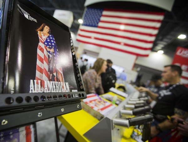 People gather around the KAHR Firearms Group during the Shot Show at the Las Vegas Sands Convention Center on Tuesday, Jan. 19, 2016. Jeff Scheid/Las Vegas Review-Journal Follow @jlscheid °  ...