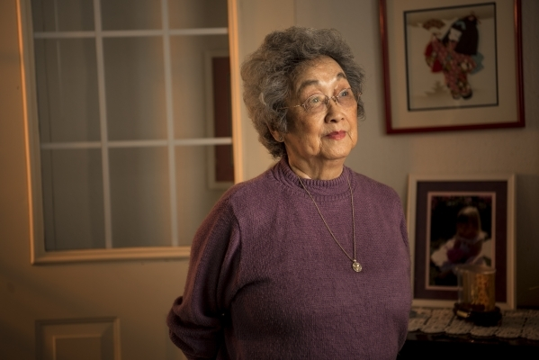 Rosie Maruki Kakuuchi poses for a photo at her home in Las Vegas on Wednesday, Jan. 20, 2016. Kakuuchi, now 90, remembers riding the train as a 16-year-old girl with her family from Los Angeles to ...