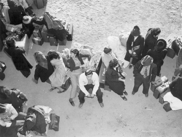 After arriving by train in Lone Pine, California, on April 1, 1942, Japanese-Americans wait for buses to take them to Manzanar, one of 10 relocation centers the government created after Japan&lsqu ...