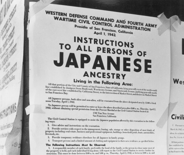 An exclusion order posted in April 1942 in San Francisco instructs people of Japanese ancestry that they must leave the area and be moved to war relocation centers. DOROTHEA LANGE/JAPANESE AMERICA ...