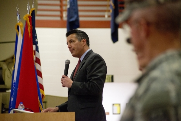 Nevada Gov. Brian Sandoval speaks during a mobilization ceremony at the Clark County Armory in Las Vegas for nearly 40 Nevada National Guard Soldiers from the 422nd Expeditionary Signal Battalion  ...