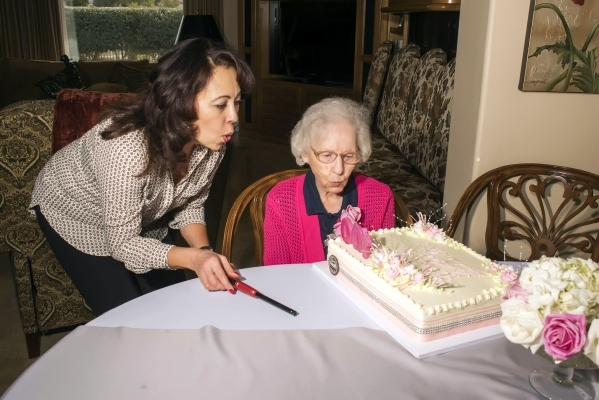 Bertha Smith blows out the candles on her birthday cake with her granddaugher Jeannette Smith while celebrating her 100th year with her family on Jan. 16. Special to View