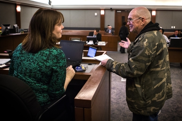 Vietnam veteran Gary Collins talks to Joanna Harrison, veteran's court coordinator for Veteran's Court Treatment Program, during an hearing at Las Vegas Municipal Court  on Friday, Jan ...