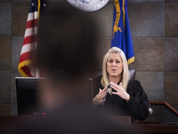 Justice of the Peace Melissa Saragosa speaks to a veteran during Veteran's Court Treatment Program hearing in Las Vegas Municipal Court on Friday, Jan. 22, 2016. The alternative program is f ...