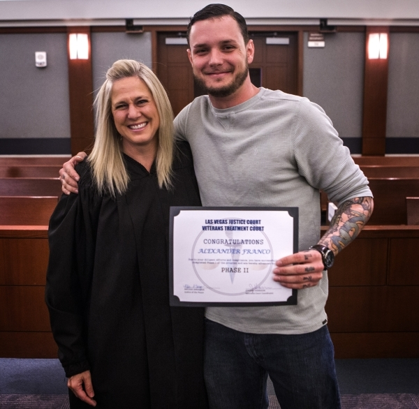 Combat veteran Alex Franco hugs Justice of the Peace Melissa Saragosa during Veteran's Court Treatment Program hearing in Las Vegas Municipal Court on Friday, Jan. 22, 2016. The alternative  ...