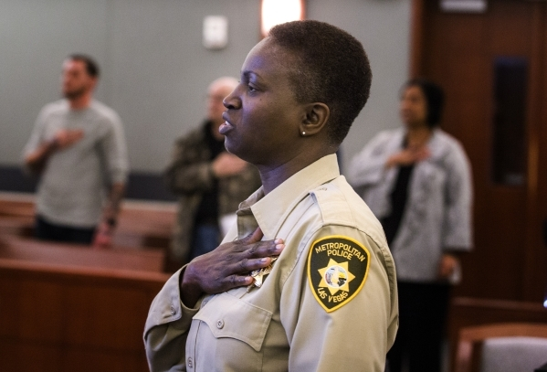 Las Vegas police house arrest officer M.Drew leads the Pledge of Allegiance during Veteran's Court Treatment Program hearing in Las Vegas Municipal Court  on Friday, Jan. 22, 2016. The alter ...