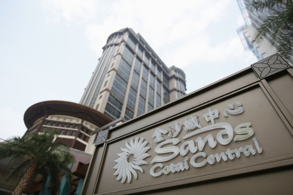 The Sands Cotai Central logo is seen Sept. 20, 2012, in front of the hotel in Macau. Macau drove Las Vegas Sands Corp. to marked declines in profits and revenue in 2015, with net income falling 30 ...