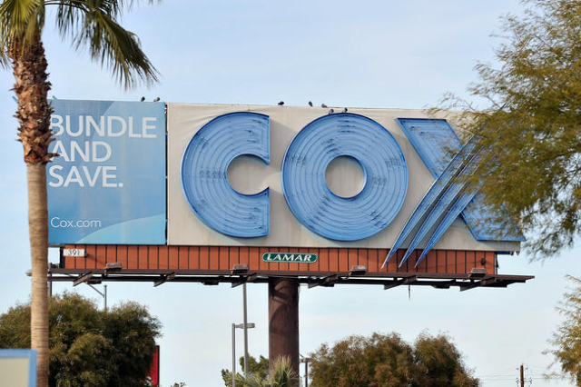 A billboard advertising cable provider Cox Communications is seen Friday, Jan. 22, 2016, in Las Vegas. The Las Vegas cable provider and KLAS, the local CBS affiliate, are currently in a negotiatio ...