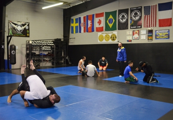 Leandro Lorenco, standing, instructs a class at Wand Fight Team Martial Arts & Fitness. Ginger Meurer/Special to View
