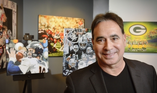 Tony Carnevale, owner and curator of the Carnevale Gallery, is shown with part of ìThe Deacon Jones Foundation NFL Fine Art in Limited Editionî exhibit in his gallery at Caesars Palace hotel ...