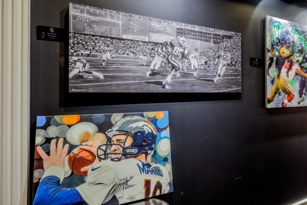 Paintings capturing 49ers wide receiver Jerry Rice, above left, and Broncos quarterback Peyton Manning, below, are part of the all-star lineup at an NFL art exhibit at the new Carnevale Gallery at ...