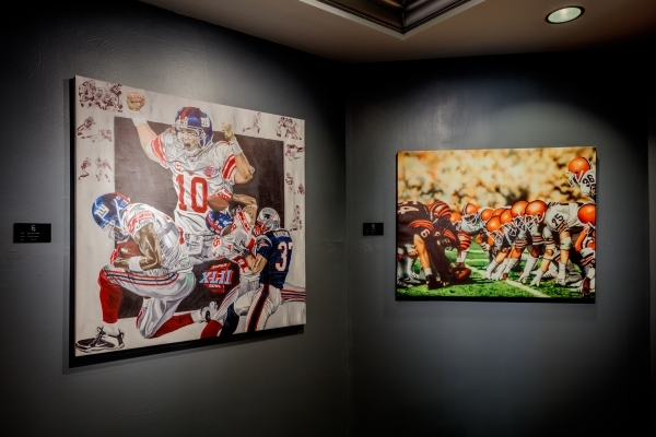 "David Courson's ""Super Bowl XLII"" and Dan Tearle's ""Trash Talk"" form part of the NFL art exhibit, licensed by the Deacon Jones Foundation, at the Carnevale Gallery  ..."