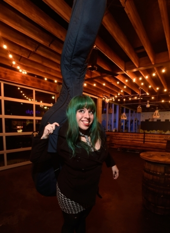 Mizz Absurd carries her upright base at the Hop Nuts Brewery on Monday, Jan. 25, 2016, in Las Vegas. Absurd along with Lee Mallory and Philena Carter are scheduled to perform at the Human Experien ...