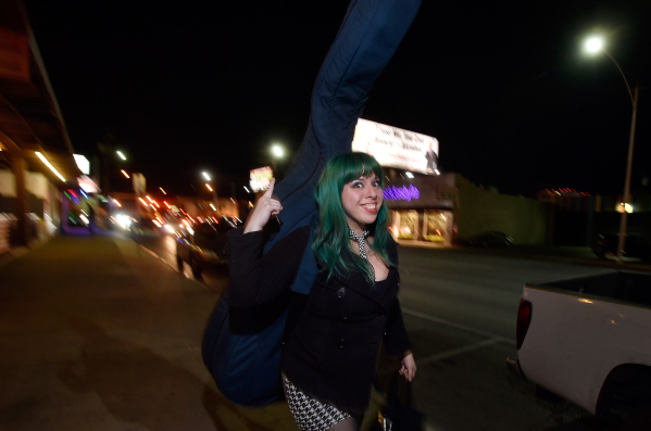 Mizz Absurd carries her upright base along Main Street near the Hop Nuts Brewery on Monday, Jan. 25, 2016, in Las Vegas. Absurd along with Lee Mallory and Philena Carter are scheduled to perform a ...
