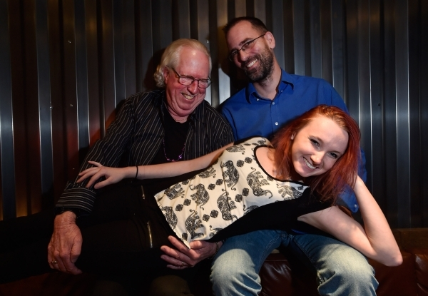 Philena Carter lies across the laps of Lee Mallory, left, and producer Paul Michelsen at the Hop Nuts Brewery on Monday, Jan. 25, 2016, in Las Vegas. Carter and Mallory, along with Mizz Absurd are ...