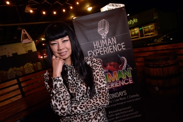 Joy Ngaosivath stands with a banner at the Hop Nuts Brewery on Monday, Jan. 25, 2016, in Las Vegas. Ngaosivath, known professionally as DJ Miss Joy, produces the Human Experience, a weekly Monday  ...