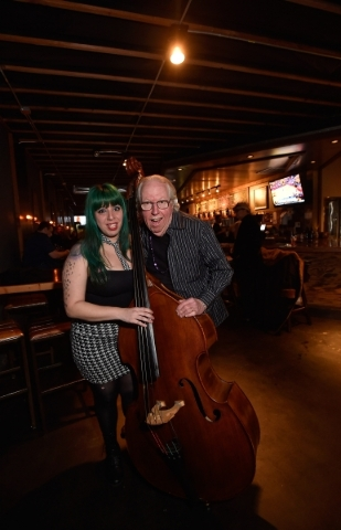 Mizz Absurd, left, and Lee Mallory pose with Absurd's upright base at the Hop Nuts Brewery on Monday, Jan. 25, 2016, in Las Vegas. The two, along with Philena Carter, are scheduled to perfor ...