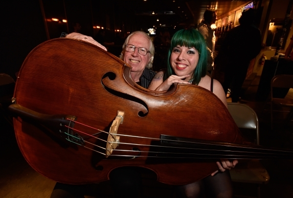Lee Mallory, left, and Mizz Absurd pose with her upright base at the Hop Nuts Brewery on Monday, Jan. 25, 2016, in Las Vegas. The two, along with Philena Carter, are scheduled to perform at the Hu ...