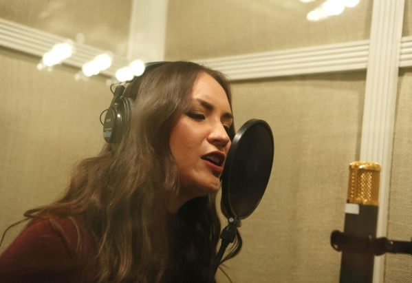 R&B/Soul and Funk performer Rosalee is shown through a window singing a portion of her new single at Omnitone Recording Studios Wednesday, Jan. 27, 2016, in Las Vegas. Rosalee collaborated wit ...