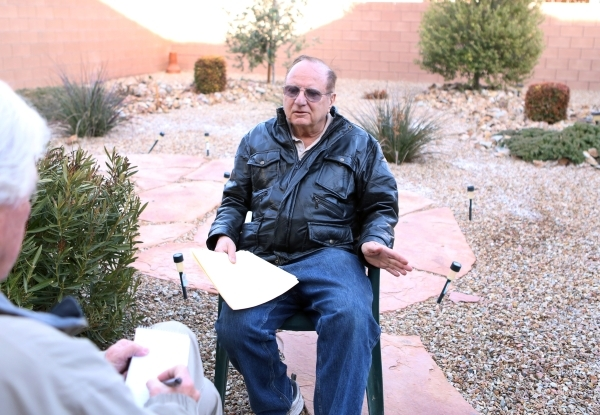 Michael Grubler, right, talks to a reporter at his Las Vegas home Monday, Jan. 25, 2016. Grubler alerted the VA to a problem in the way its phone system works for fielding calls from veterans cont ...