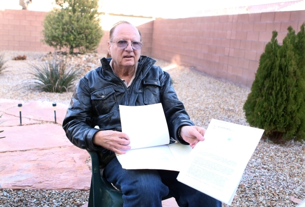 Michael Grubler shows a letter he received from Department of Veterans Affairs during an interview at his Las Vegas home Monday, Jan. 25, 2016. Grubler alerted the VA to a problem in the way its p ...