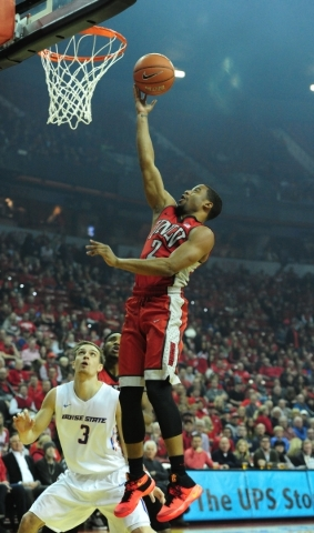 UNLV guard Jerome Seagears (2) goes up for a shot against Boise State guard Anthony Drmic (3) in the first half of their NCAA Basketball game at the Thomas & Mack Center in Las Vegas Wednesday ...
