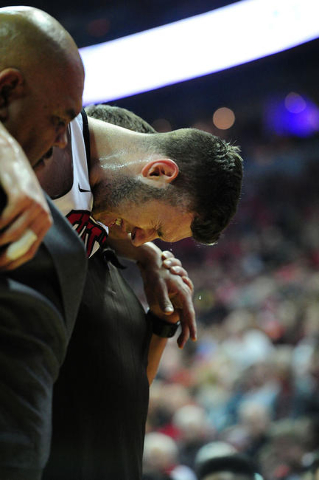 UNLV forward Ben Carter (13) is helped off the floor after suffering a torn ACL in the first half of their NCAA college basketball game against San Diego State at the Thomas & Mack Center in L ...