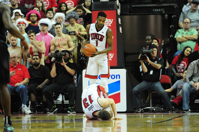 UNLV forward Ben Carter (13) lies injured on the floor after tearing a torn ACL as Derrick Jones Jr. (1) looks on in the first half of their NCAA college basketball game at the Thomas & Mack C ...