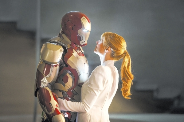 """This film publicity image released by Disney-Marvel Studios shows Gwyneth Paltrow as Pepper Potts with  in a scene from """"Iron Man 3.""""  (AP Photo/Disney, Marvel Studios)"""