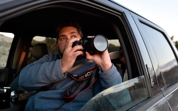 Director David Lamfrom of the California Desert and National Wildlife snaps a photograph as he tours the high desert area of the Castle Mountains Monday, Feb. 1, 2016. (David Becker/Las Vegas Revi ...