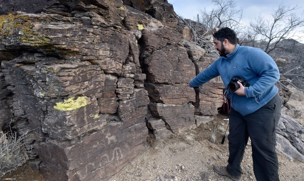 Director David Lamfrom of the California Desert and National Wildlife points out petroglyphs on an outcropping of rocks as he tours the high desert area of the Castle Mountains Monday, Feb. 1, 201 ...