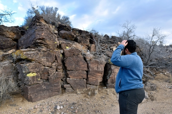 Director David Lamfrom of the California Desert and National Wildlife ponders the meaning of petroglyphs found as he tours the high desert area of the Castle Mountains Monday, Feb. 1, 2016. A 29,0 ...
