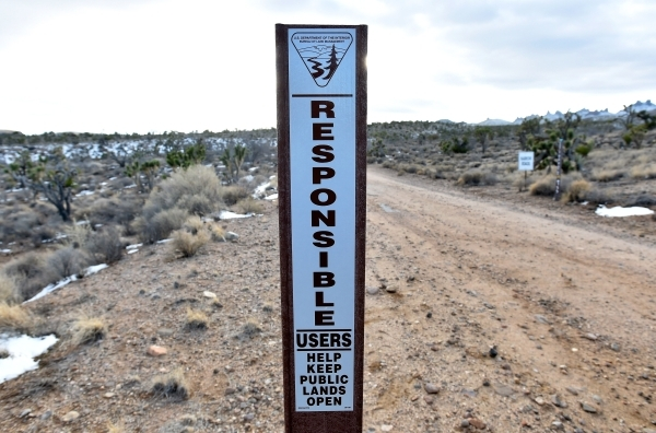 A Bureau of Land Management signpost marks the state line separating Nevada and California in the high desert area of the Castle Mountains Monday, Feb. 1, 2016. A 29,000 acre parcel southwest of S ...