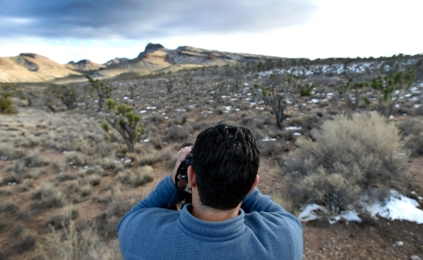 Director David Lamfrom of the California Desert and National Wildlife snaps a photograph as he tours the high desert area of the Castle Mountains Monday, Feb. 1, 2016. A 29,000 acre parcel southwe ...