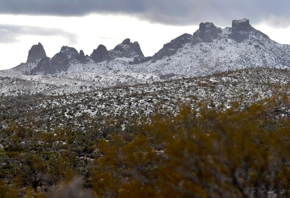 The snow-covered Castle Peaks in the high desert area near the Castle Mountains are seen Monday, Feb. 1, 2016. A 29,000 acre parcel southwest of Searchlight in California is proposed as a national ...