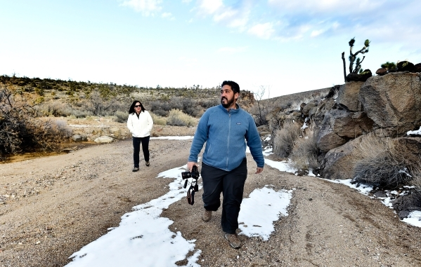 Senior program manager Lynn Davis, left, of the National Parks Conservation Association and director David Lamfrom of the California Desert and National Wildlife, tour the high desert area of the  ...