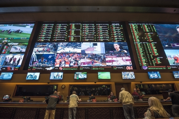 Bettors are seen at the Red Rock Resort sports book in Las Vegas on Saturday, Jan. 30, 2016. Joshua Dahl/Las Vegas Review-Journal