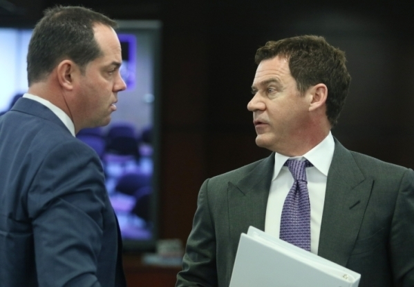 Station Casinos' Marc Falcone, left, chief financial officer, exchanges words with Richard Haskins, president, during a Gaming Control Board hearing at Grant Sawyer building Thursday, Jan. 2 ...
