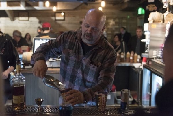 Rick Harrison prepares drinks for fans in the upstairs bar at Rollin Smoke Barbeque in Pawn Plaza at 725 Las Vegas Blvd. South in Las Vegas Friday, Jan. 29, 2016. Jason Ogulnik/Las Vegas Review-Jo ...