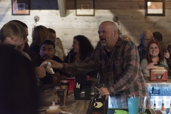 Rick Harrison hands a signed hat back to a fan in the upstairs bar at Rollin Smoke Barbeque in Pawn Plaza at 725 Las Vegas Blvd. South in Las Vegas Friday, Jan. 29, 2016. Jason Ogulnik/Las Vegas R ...