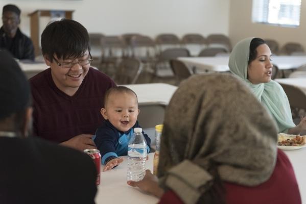 Eugene Lee, left, holds his 10-month-old son Isaac Lee during a neighborhood get together for Masjid Ibrahim's opening weekend in Las Vegas Saturday, Jan. 30, 2016. Jason Ogulnik/Las Vegas R ...