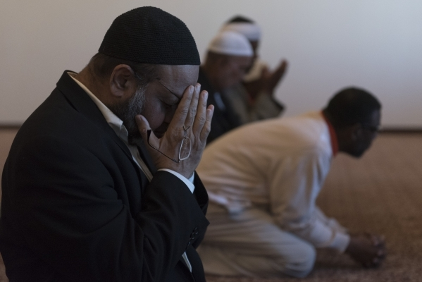 Dr. Aslam Abdullah, left, is seen during a prayer session at Masjid Ibrahim during a neighborhood get together for the mosque's opening weekend in Las Vegas Saturday, Jan. 30, 2016. Jason Og ...