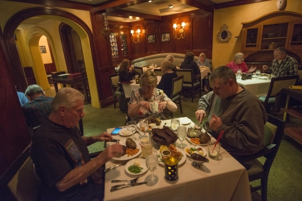 Henry Bernier, Barbara Bernier and Greg Bernier enjoy a meal at Yukon Grille in Arizona Charlie's on Saturday, Jan. 30, 2016. Youkon Grille is a steakhouse that features seafood, desserts, c ...