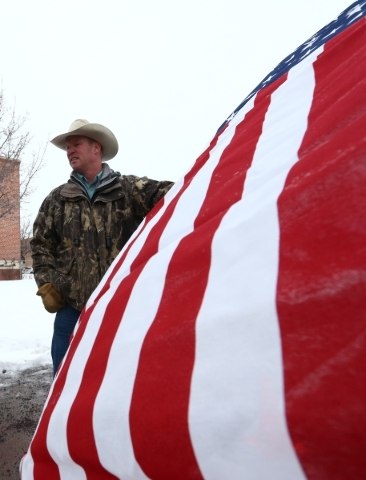 Local resident Mitch Siegner protests the shooting death of LaVoy Finicum, who was killed Tuesday night during an attempted arrest by FBI and Oregon State Police officers, outside of Harney County ...