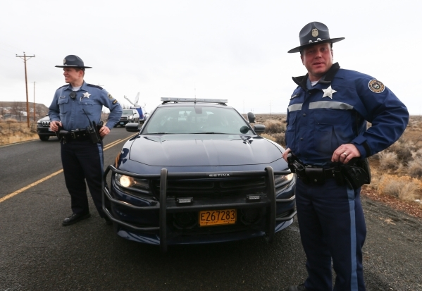 Oregon State Police stand by a roadblock near the Malheur National Wildlife Refuge headquarters, where four anti-government protesters remain, about 30 miles south of Burns, Ore., on Friday, Jan.  ...