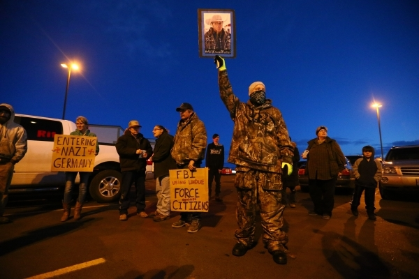 """People gather for a """"rolling"""" protest of the shooting death of LaVoy Finicum, who was killed Tuesday night during an attempted arrest by FBI and Oregon State Police officers, outside of  ..."""